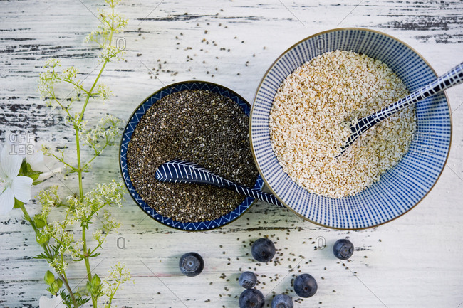 Bowls of black chia seeds and amaranth