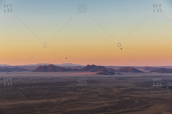Africa- Namibia- Namib desert- Namib-Naukluft National Park- Aerial view of desert dunes in the morning light- air balloons