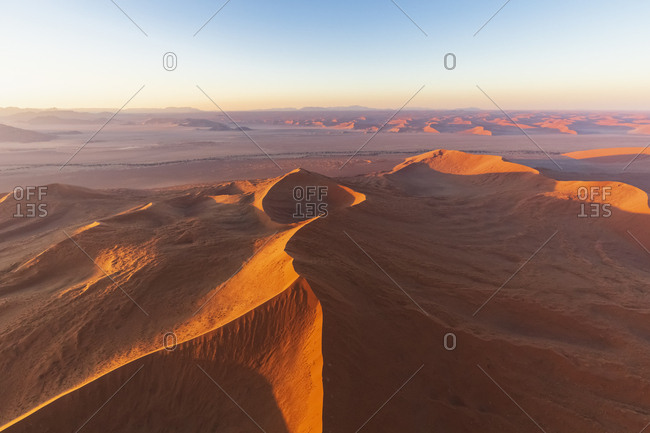 Africa- Namibia- Namib desert- Namib-Naukluft National Park- Aerial view of desert dunes in the morning light