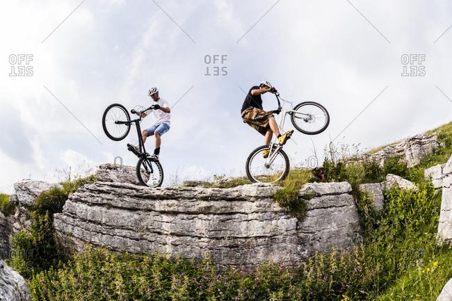 Acrobatic bikers on trial bikes