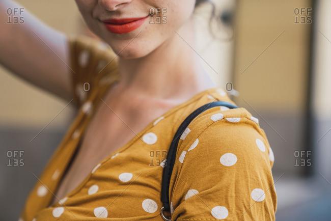Beautiful woman wearing yellow dress with polka dots