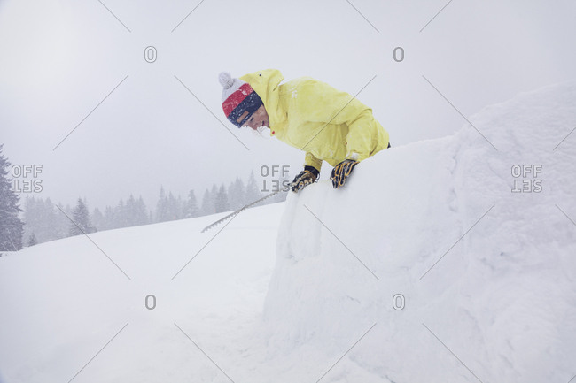 Woman building an igloo