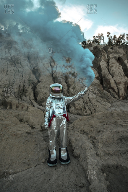 Abandoned spaceman giving smoke signals