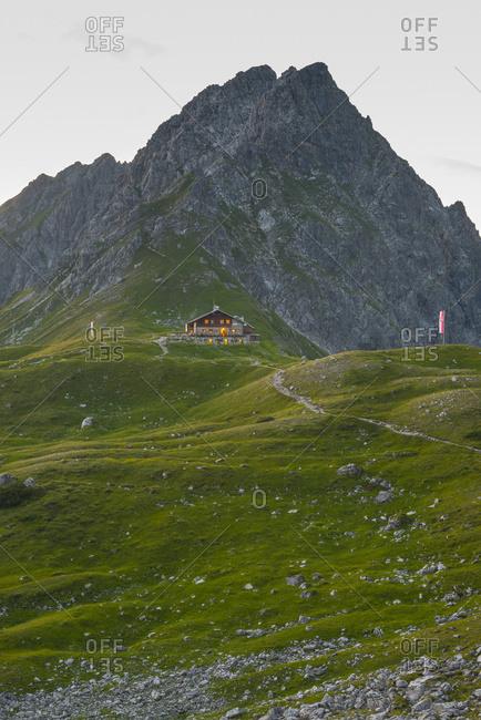 Germany- Bavaria- Allgaeu- Allgaeu Alps- Fiderepass hut and Hammerspitze in the evening