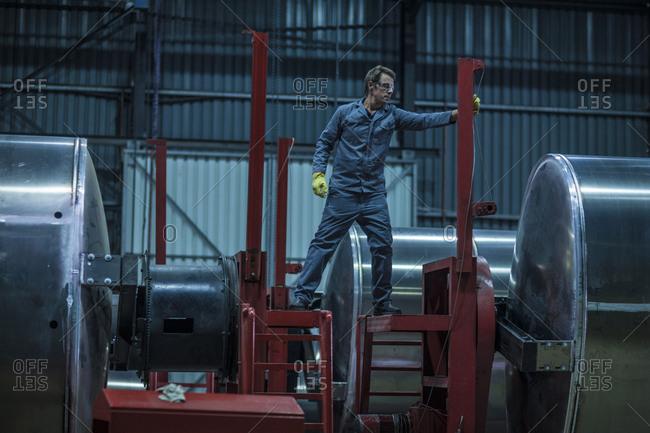 Worker in steel factory