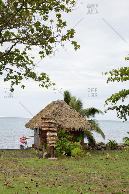 Traditional hut and boat in Tahiti