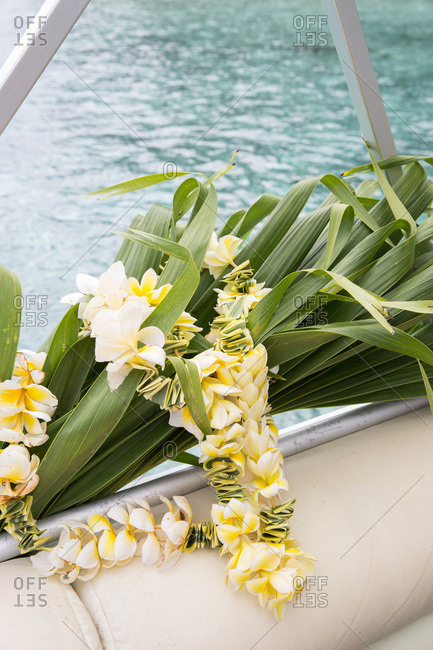 Polynesian lei with yellow flowers and palm leaves