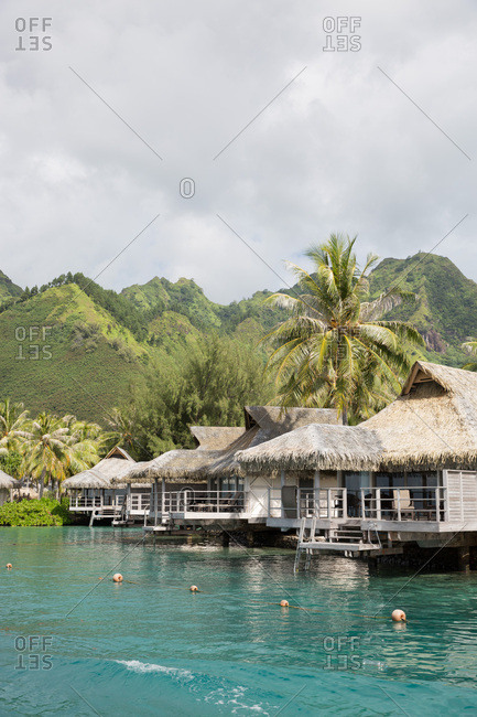 Overwater bungalows on tropical beach in Mo'orea