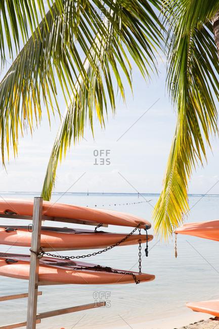 Stack of kayaks on tropical beach in Tahiti