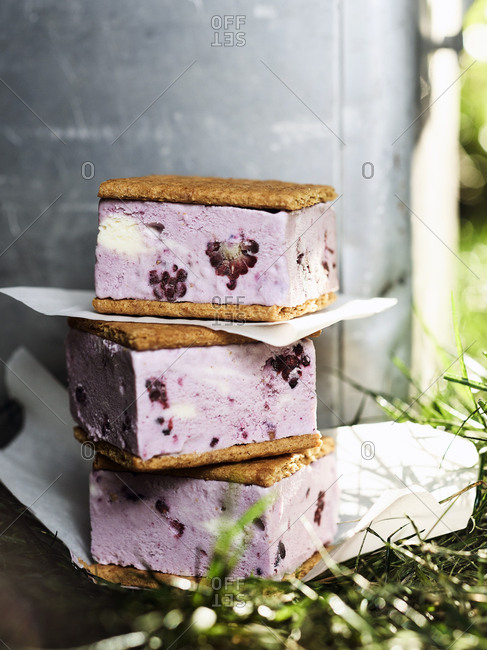 Blackberry ice cream sandwiches on parchment paper