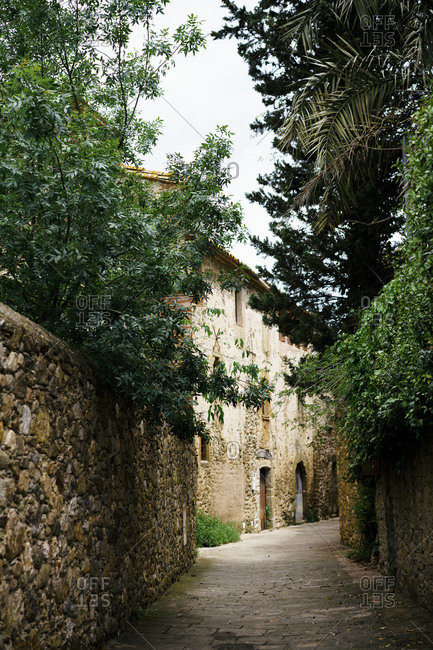 Old alleyway with stone walls in Spain