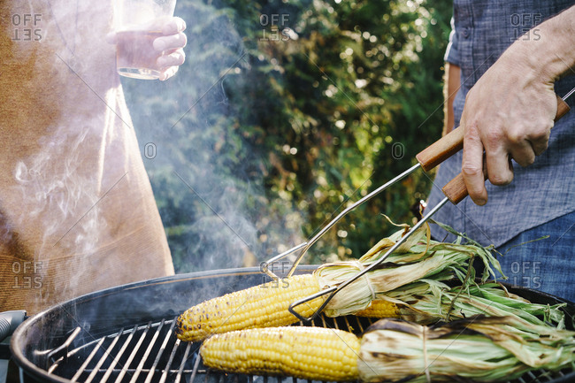 Corn on the cob being grilled on a grill