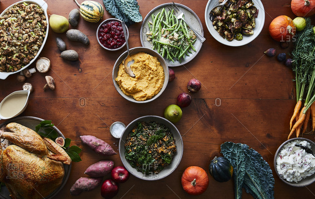 Overhead view of a holiday meal and fresh produce