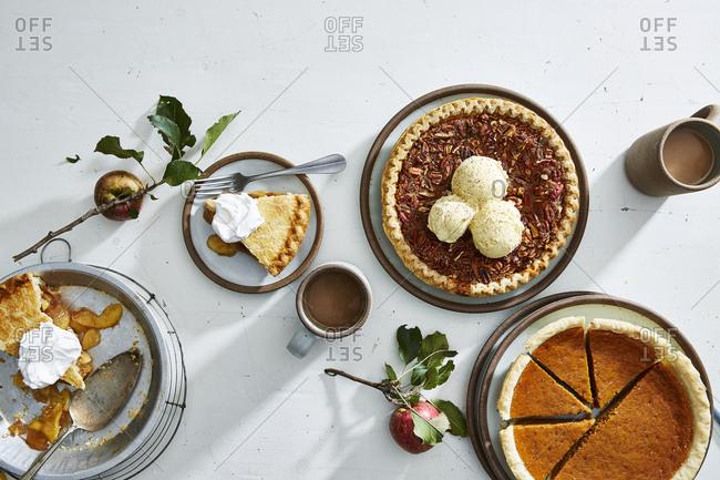 Three pies and fresh fruit