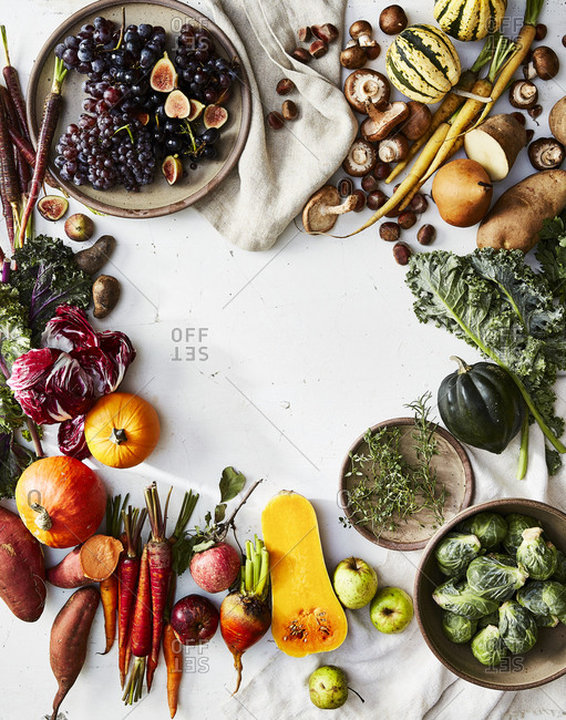 Variety of colorful fresh produce on light background