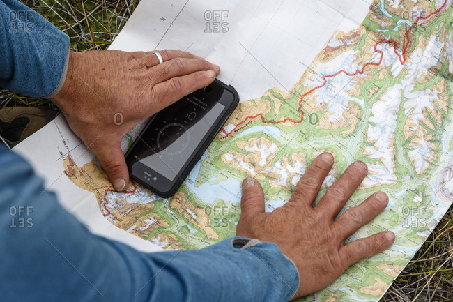 Patagonia, Aysen Region, Chile - February 15, 2016: Man using map to navigate at the Chacabuco Valley, Parque Patagonia