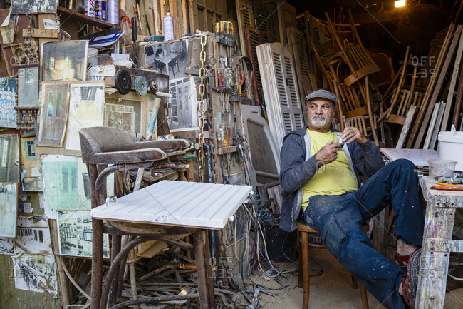 Jaffa, Israel - March 30, 2016: Portrait of man working in his studio at the Jaffa flea market as a door and window frame restorer
