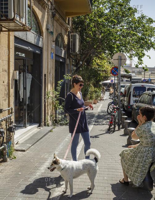 Jaffa, Israel - April 3, 2016: Women chatting at the area of the flea market in Jaffa
