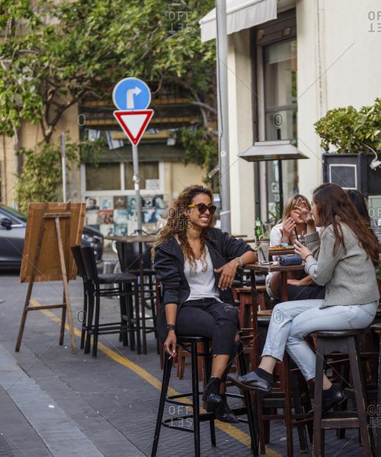 Jaffa, Israel - April 3, 2016: Women sitting at a bar in the Flea Market area, Jaffa, Israel