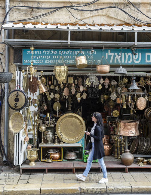 Jaffa, Israel - March 30, 2016: Woman looking at an antique store in the flea market, Jaffa, Israel