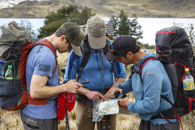 Patagonia, Aysen Region, Chile - February 15, 2016: Men looking at map in the Chacabuco Valley, Parque Patagonia, Aysen Region, Chile