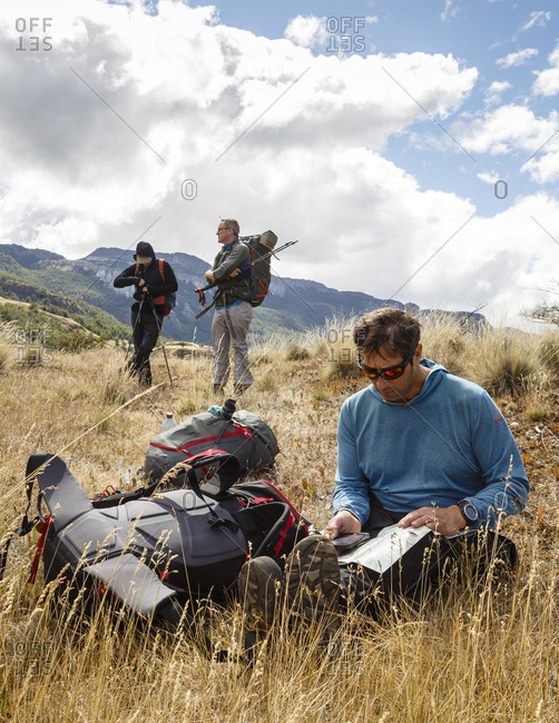Patagonia, Aysen Region, Chile - February 16, 2016: Men in the Chacabuco Valley, Parque Patagonia, looking at maps