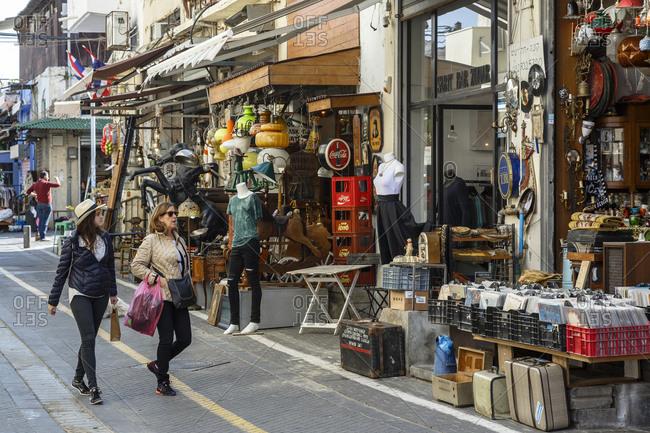 Jaffa, Israel - March 30, 2016: Women walking by antique shops at the Flea Market area, Jaffa, Israel