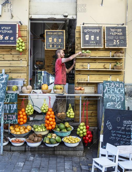 Jaffa, Israel - March 30, 2016: Fruit juice stall at the Flea Market area, Jaffa, Israel