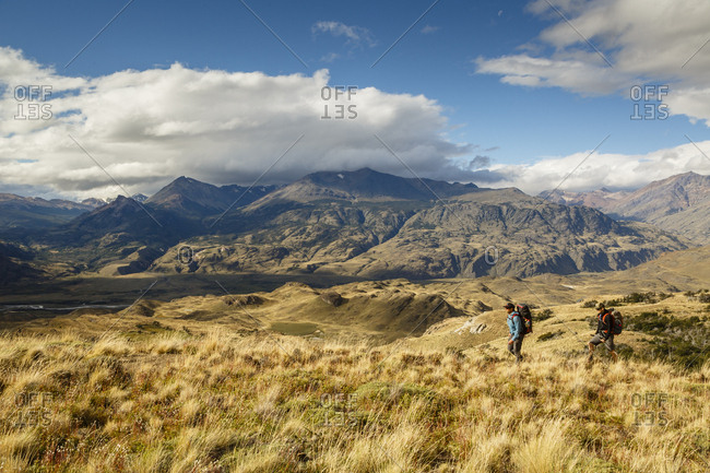 Patagonia, Aysen Region, Chile - February 15, 2016: Men hiking at the Chacabuco Valley, Parque Patagonia
