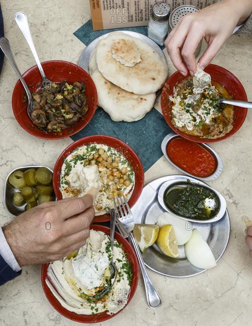 Jaffa, Tel Aviv, Israel - December 13, 2015: Hummus plates at Shlomo and Doron Hummus place at the Carmel Market, Tel Aviv, Israel