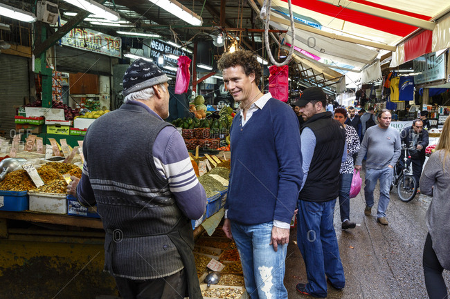 Jaffa, Tel Aviv, Israel - December 13, 2015: Men at the Carmel Market, Tel Aviv, Israel