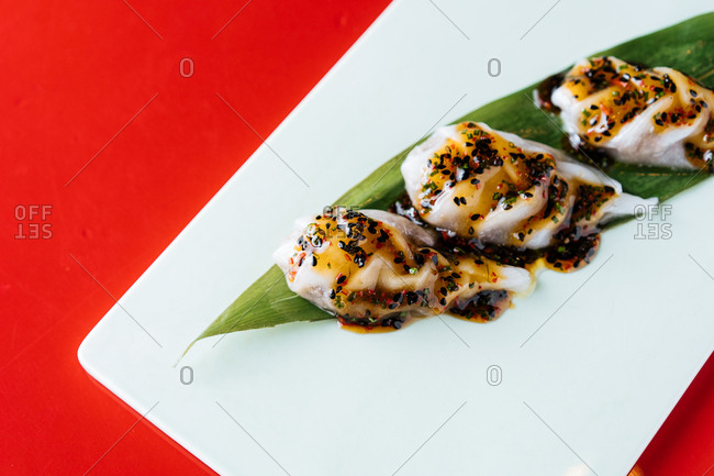 Gourmet appetizer on a dish on red background