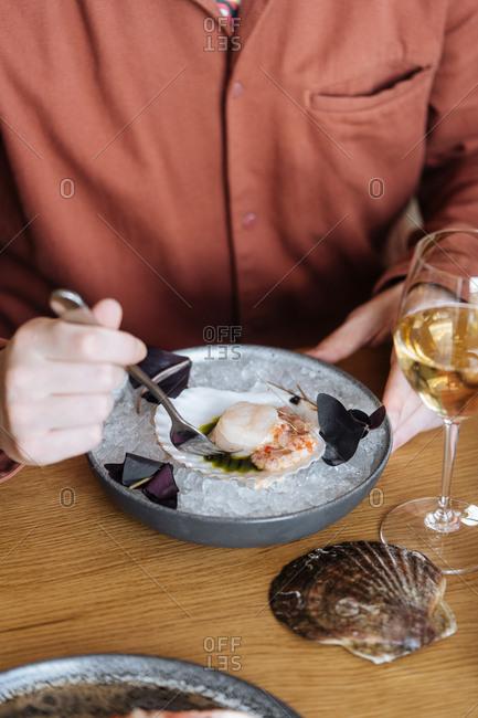 Man eating a gourmet seafood appetizer