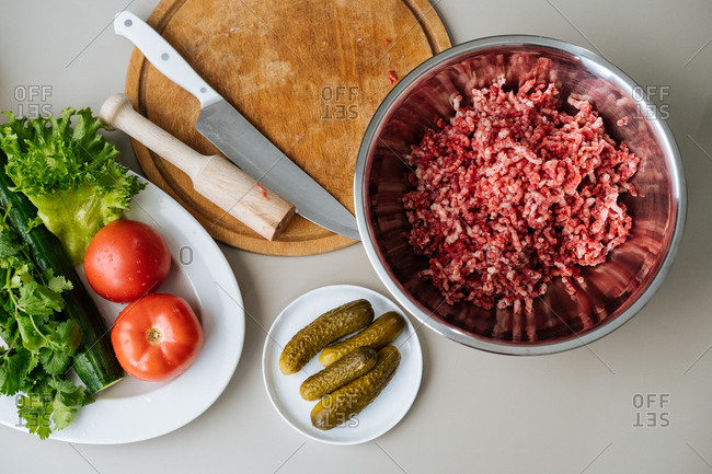 Overhead view of hamburger meat and ingredients