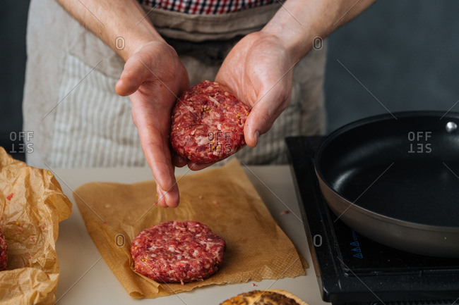 Man shaping meat for hamburgers