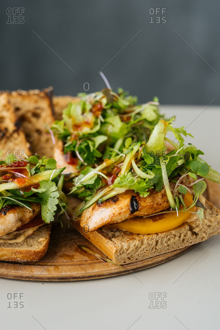 Chicken sandwich with veggies and sauce