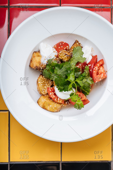 Fried plantains with tomato and cilantro