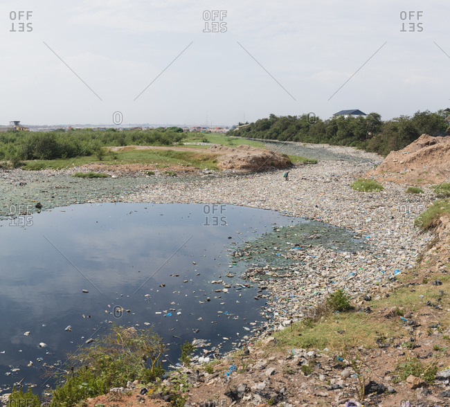 A river filled with trash and waste, in Accra, Ghana
