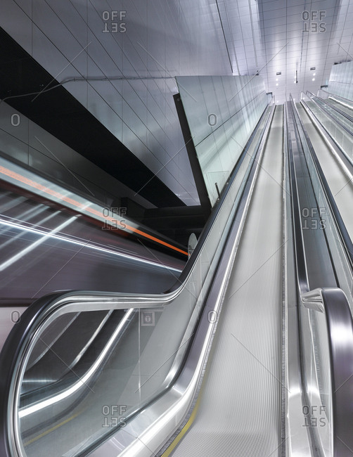 Subway cars speeding past the escalator of the new Vijzelgracht station subway station in Amsterdam.