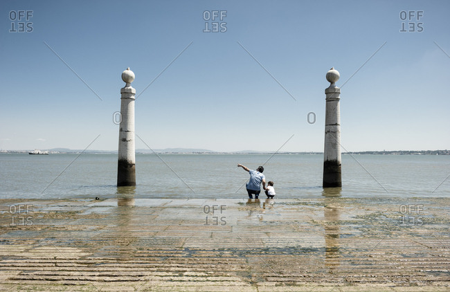 May 31, 2014: Man shows his boy the seaview from the Commerce Square ( Praca do Comercio ) in Lisbon, Portugal.
