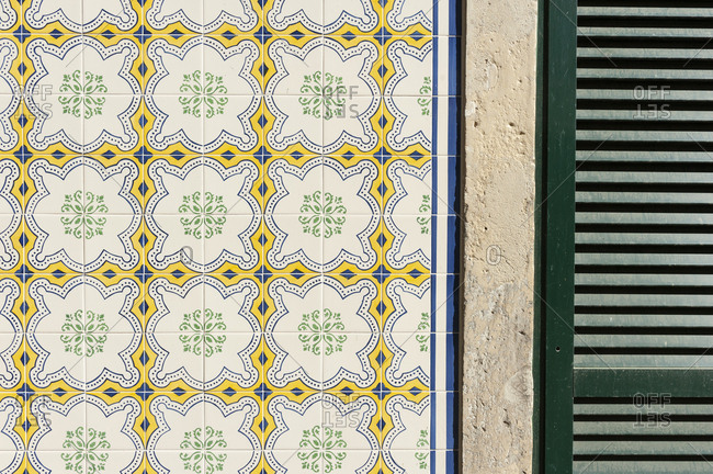 Old tiles on a house in the city center of Lisbon.