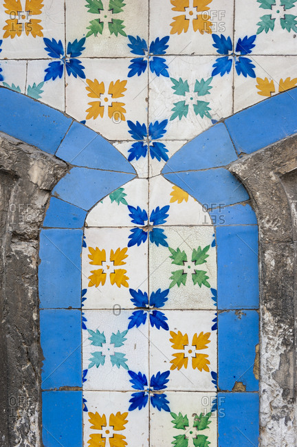 A building full of colorful tiles, in the Alfama neighborhood in Lisbon, Portugal.