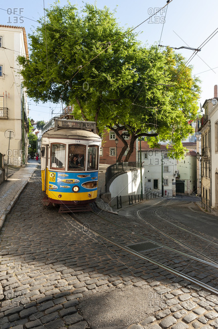 June 2, 2014: Historic tram 12 on an intersection in the Alfama neighborhood, Lisbon, Portugal