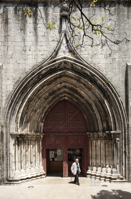 June 2, 2014: Old man coming out of the Carmo convent on Carmo Square in the center of Lisbon.