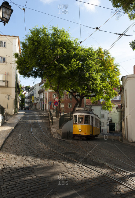 June 3, 2014: Historic tram 28 on an intersection in the Alfama neighborhood, Lisbon, Portugal