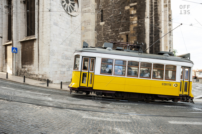 June 3, 2014: Old tram riding the streets in front of the Patriarcado de Lisboa, the Cathedral of Lisbon.