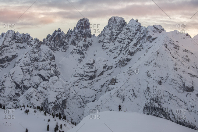 Trekker with snowshoes at sunset, looking the Piz Popena and Cristallo Mount form Prato Piazza, Braies, Trentino Alto Adige, Italy, Europe