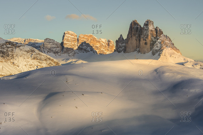 The summit cross of the Specie Mount and the Tre Cime di Lavaredo on background at sunset, Prato Piazza, Braies, Trentino Alto Adige, Italy, Europe