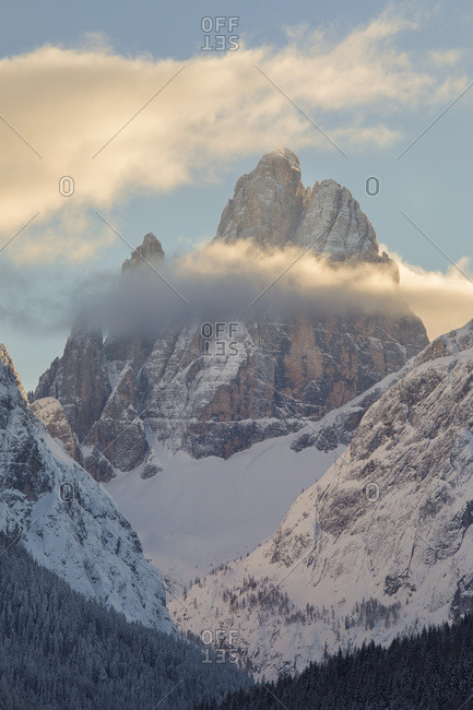 The Croda Dei Toni shrouded by the clouds at dawn, Sesto, Pusteria valley, dolomites, Trentino Alto Adige, Italy, Europe