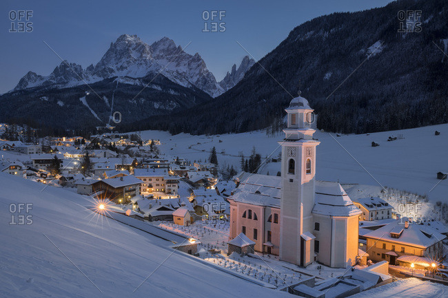 January 21, 2018: The village of Sesto with its church by night, Pusteria valley, Trentino Alto Adige, Italy